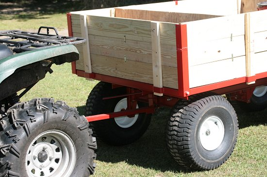 ATV towing firewood cutting trailer